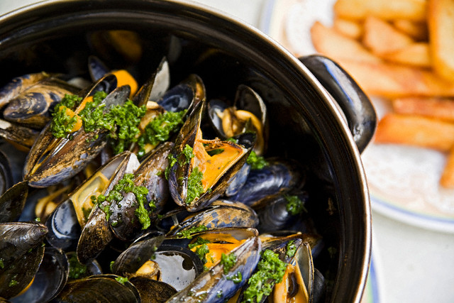 "Mussles and chips, typical ""moules et frites"""